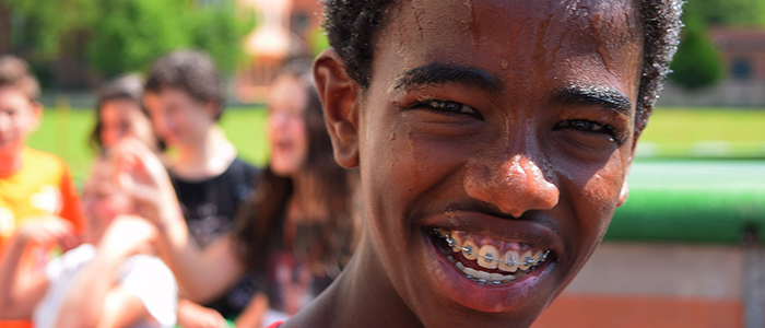 Young, sweaty man smiling with braces