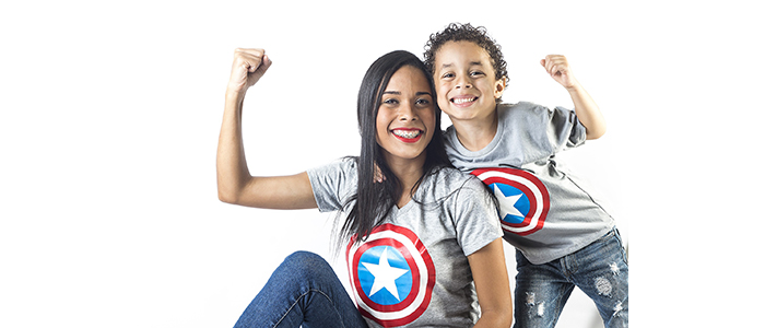 a mom and her son smiling and posing in Captain America t-shirts