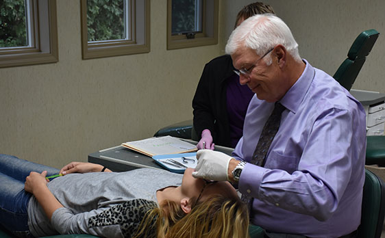 Dr. Rykovich examining a female patient